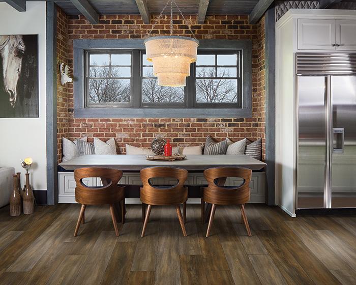 Coles Fine Flooring   Karastan Luxury Vinyl Plank dining nook with brick