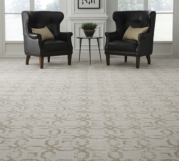 Coles Fine Flooring | tan patterned carpet and chairs
