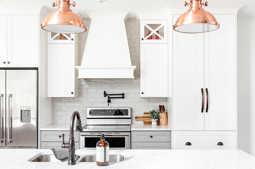 Coles Fine Flooring | White kitchen with Statement lighting