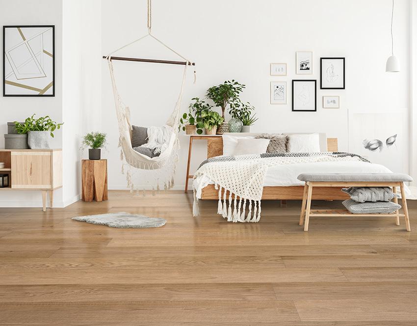 Coles Fine Flooring | yellow toned hardwood bedroom